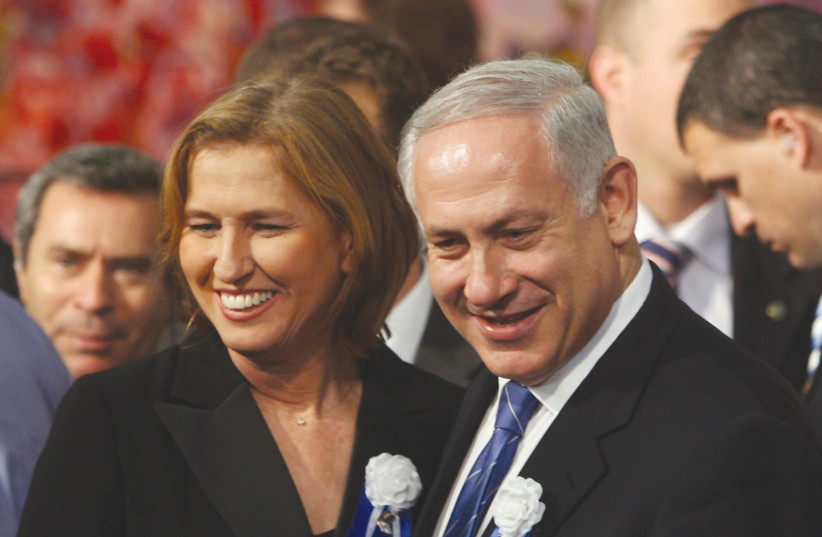 LIKUD PARTY leader Benjamin Netanyahu and Kadima Party head Tzipi Livni attend the swearing-in ceremony of the 18th Knesset in 2009 (photo credit: JIM HOLLANDER / POOL / REUTERS)