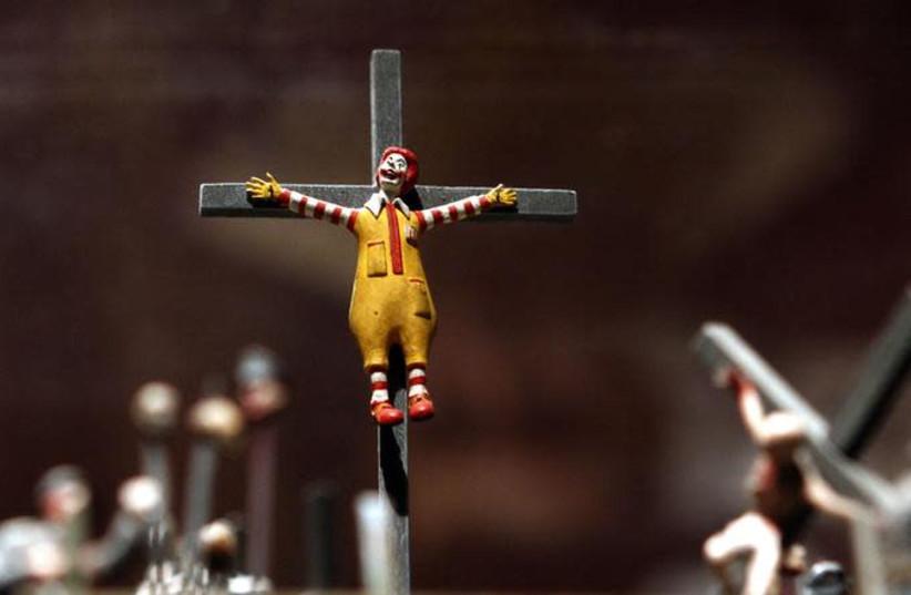 A figure of a crucified Ronald McDonald (photo credit: REUTERS/ALEXANDER DEMIANCHUK)
