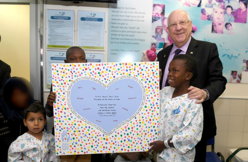 President Reuven Rivlin visits children treated for Save a Child's Heart (credit: Mark Neiman/GPO)