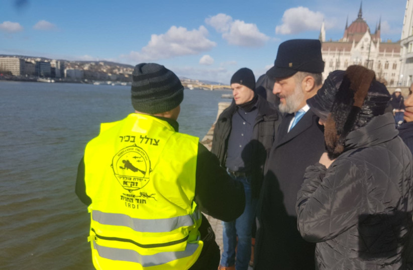 Deri, escorted by ZAKA divers, is standing at the banks of the Danube in Hungary (photo credit: ZAKA RESCUE AND RECOVERY ORGANIZATION)