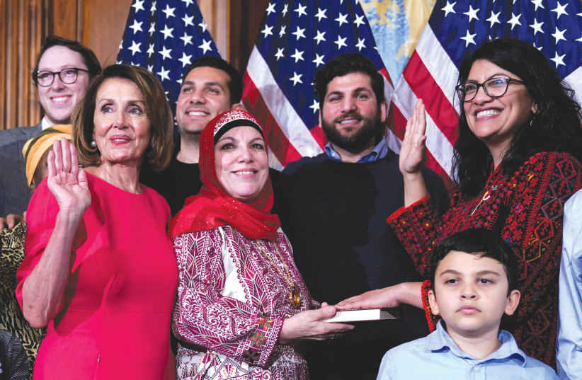 REP. RASHIDA Tlaib (D-Michigan, far right) poses with Speaker of the House Nancy Pelosi (D-California) for a ceremonial swearing-in picture on Capitol Hill on January 3 (photo credit: JOSHUA ROBERTS / REUTERS)