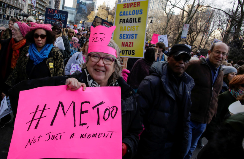 People take part in the Women's March in Manhattan in New York City, New York, U.S., January 20, 2018. (photo credit: REUTERS/EDUARDO MUNOZ)