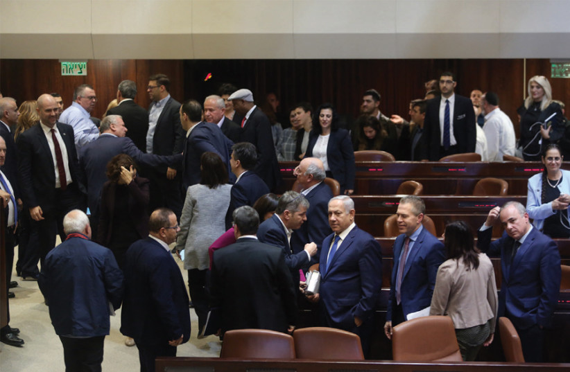 A scene in the Knesset before it votes for an early election on April 9 (photo credit: MARC ISRAEL SELLEM)