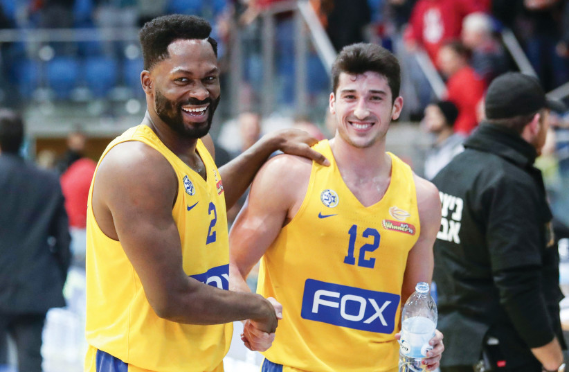 MACCABI TEL AVIV guards Jeremy Pargo (left) and John DiBartlomeo (right) are all smiles after the yellow-and-blue coasted to a 99-76 road victory over Hapoel Beersheba on Monday night in Basketball Super League action.  (photo credit: DANNY MARON)