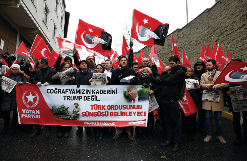 MEMBERS OF Vatan (Patriotic) Party wave flags of Turkey and of their party during a protest against US President Donald Trump near the US Consulate in Istanbul yesterday. The banner reads 'The destiny of our geography will not be determined by Trump but by the bayonet of the Turkish army.' (photo credit: HUSEYIN ALDEMIR/REUTERS)