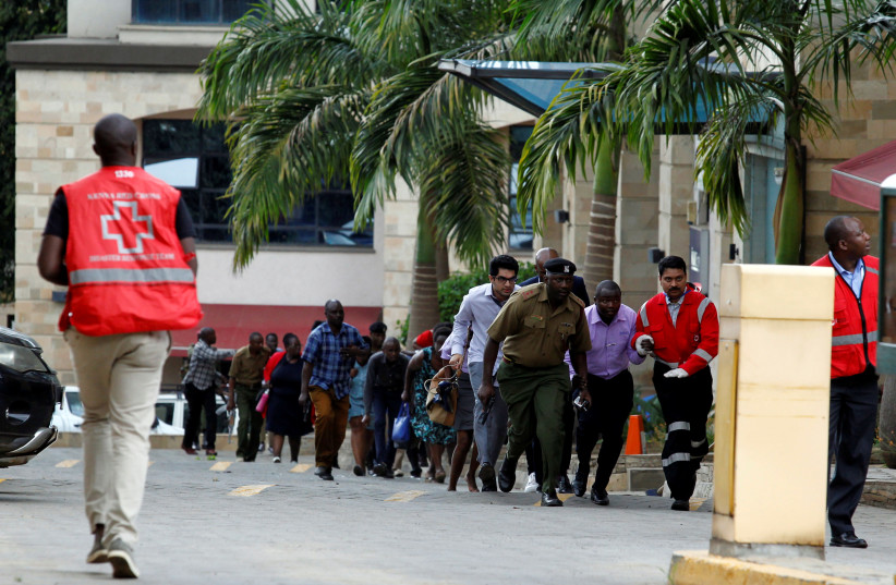 Rescuers and security agents evacuate civilians from the scene where explosions and gunshots were heard at the Dusit hotel compound, in Nairobi, Kenya January 15, 2019. (photo credit: NJERI MWANGI/REUTERS)