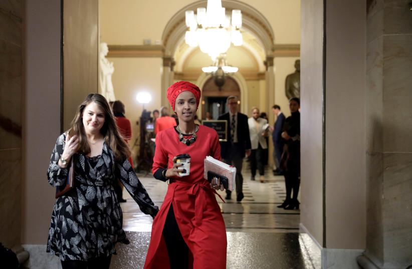 Rep. Ilhan Omar (D-MN) walks on Capitol Hill (photo credit: YURI GRIPAS/REUTERS)