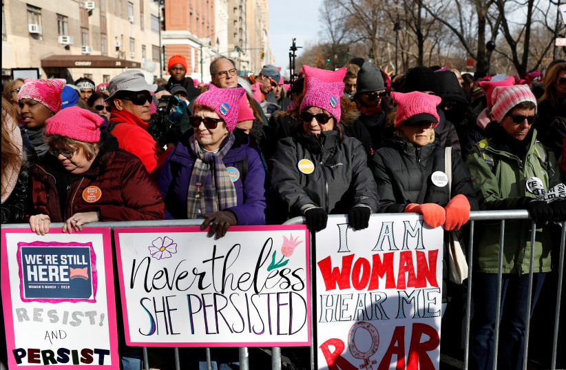 People line Central Park West as they participate in the Women's March in Manhattan, New York City, New York, U.S., January 20, 2018 (photo credit: ANDREW KELLY / REUTERS)