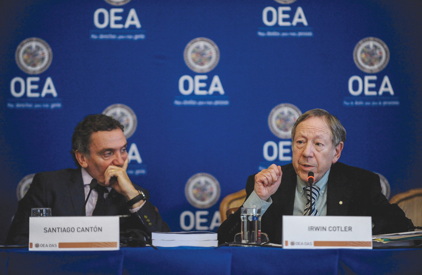 IRWIN COTLER participates in a news conference of the Organization of American States (OEA in French) in May.  (photo credit: REUTERS)