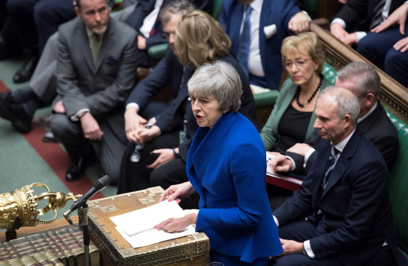 BRITISH PRIME MINISTER Theresa May speaks during a confidence vote debate after Parliament rejected her Brexit deal, in London, Wednesday.  (photo credit: REUTERS/JESSICA TAYLOR)