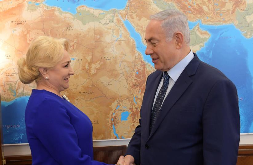 Prime Minister Benjamin Netanyahu shakes hands with Romanian Prime Minister Viorica Dăncilă (photo credit: AMOS BEN-GERSHOM/GPO)