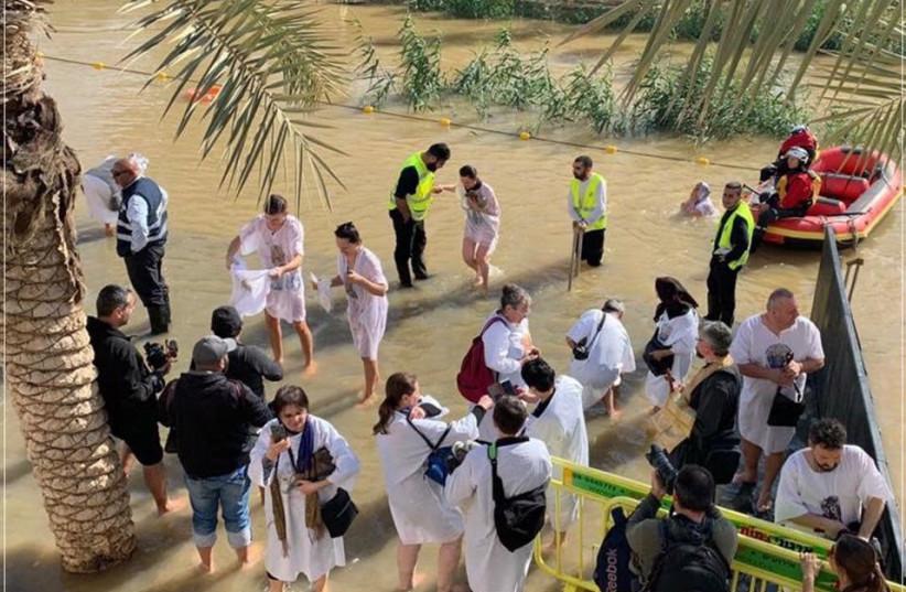 Pilgrims enter the Jordan River during the celebration of the Epiphany, Friday January 18 2019 (photo credit: Courtesy)