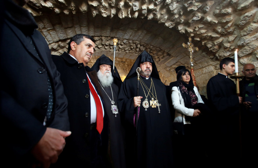 Armenian Patriarch of Jerusalem Nourhan Manougian arrives to lead a mass at the Church of the Nativity in Bethlehem January 18, 2019. (photo credit: MUSSA QAWASMA / REUTERS)