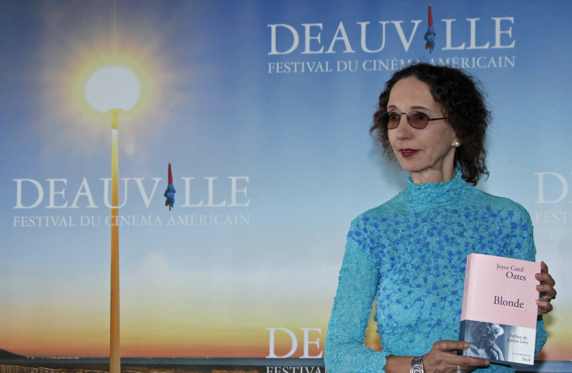 """Writer Joyce Carol Oates poses with her book """"Blonde"""" during a photocall after she won the Literary Award at the 36th American film festival in Deauville September 9, 2010.  (photo credit: REUTERS/VINCENT KESSLER)"""