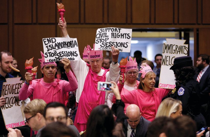 MEMBERS OF Code Pink protest before US Attorney-General Jeff Sessions testifies before a Senate Judiciary oversight hearing on Capitol Hill in 2017 (photo credit: JOSHUA ROBERTS / REUTERS)
