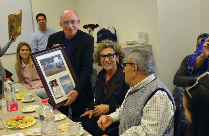 UNIVERSITY OF HAIFA president Prof. Ron Robin honors Younes and Soraya Nazarian with a plaque commemorating the family's contributions to the University (photo credit: UNIVERSITY OF HAIFA)