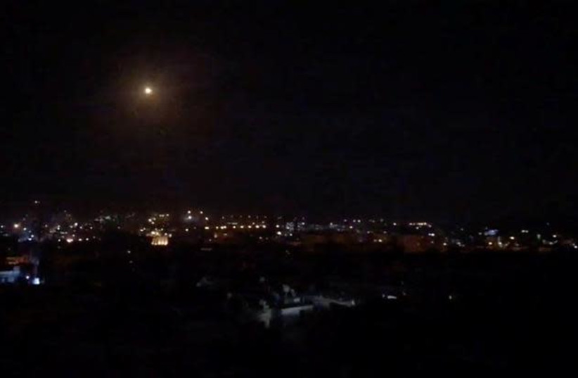 What is believed to be guided missiles are seen in the sky during what is reported to be an attack in Damascus, Syria, January 21, 2019, in this still image taken from a video obtained from social media (photo credit: FACEBOOK DIARY OF A MORTAR SHELL IN DAMASCUS/YOUMIYAT QADIFAT HAWUN FI DAMASHQ/VIA REUTERS)