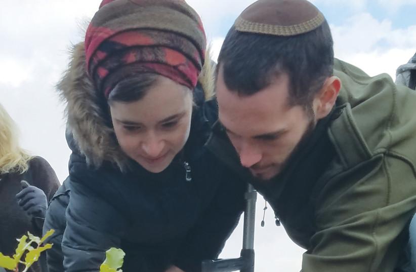 Shira and Amichai Ish-Ran plant a tree on Tu B'shevat (photo credit: Courtesy)