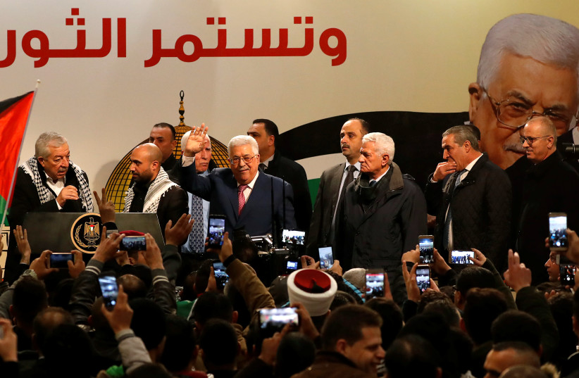 Palestinian President Mahmoud Abbas gestures during a ceremony marking the 54th anniversary of Fatah's founding, in Ramallah, December 31, 2018 (photo credit: MOHAMAD TOROKMAN/REUTERS)