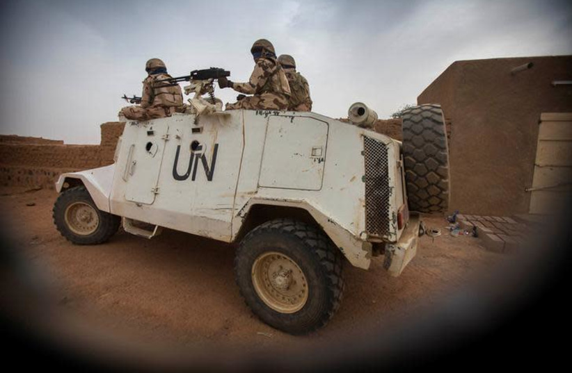 Members of MINUSMA Chadian contingent patrol in Kidal, Mali (photo credit: REUTERS)