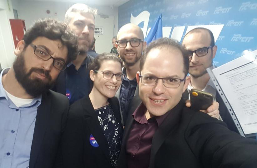 New Likudnik primaries candidates L-R Meiri, Klarman, Weisman-Simhony, Assaf Rothem, Hirshman, and Toyerman take a selfie outside the party's court last week. (photo credit: Courtesy)