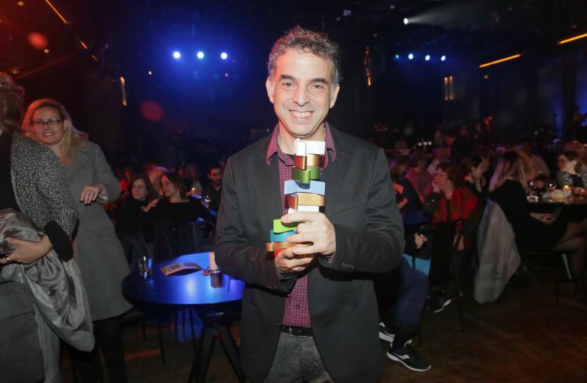 Etgar Keret holds his Sapir Prize at the ceremony on Monday night. (photo credit: SHUKA COHEN)