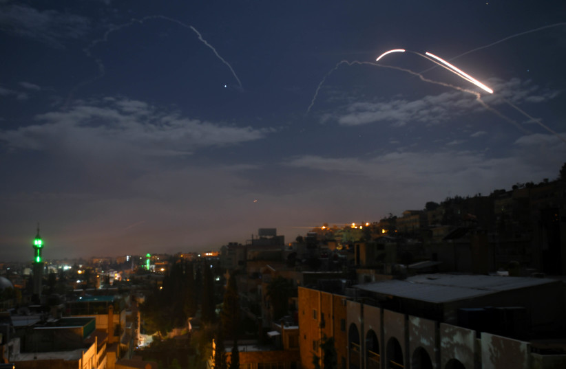 Syrian air defence batteries responding to what the Syrian state media said were Israeli missiles targeting Damascus, in a picture taken early on January 21st, 2019 (photo credit: STR / AFP)