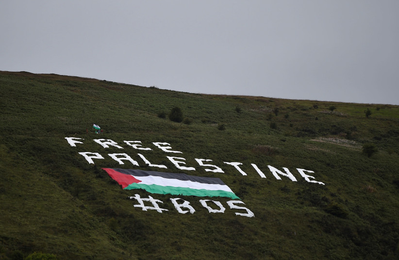 Soccer Football - International Friendly - Northern Ireland v Israel - Windsor Park, Belfast, Britain - September 11, 2018 Free Palestine message displayed on a hill outside the stadium (photo credit: CLODAGH KILCOYNE/REUTERS)