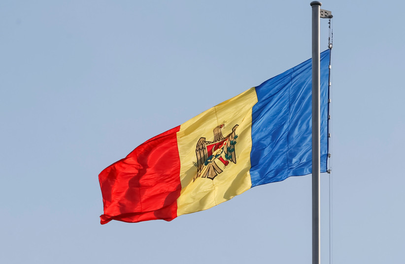 Moldova's national flag is seen in central Chisinau, Moldova (photo credit: GLEB GARANICH / REUTERS)