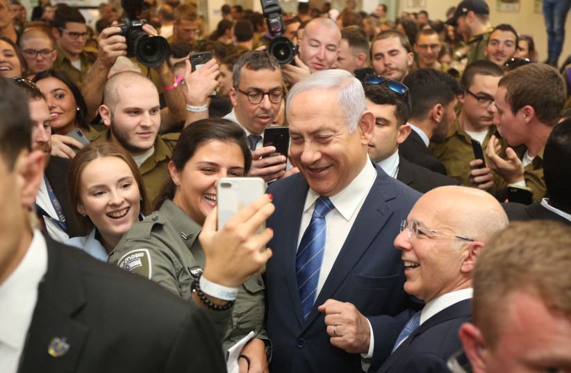 Prime Minister and Defense Minister Benjamin Netanyahu in a lone soldier event in Tel Aviv on January 24, 2019 (photo credit: MARC ISRAEL SELLEM/THE JERUSALEM POST)