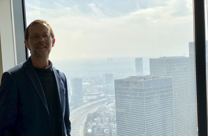 Moshe Feiglin, head of the Zehut party, in a meeting with a view of the Tel Aviv skyline. (photo credit: Lahav Harkov)