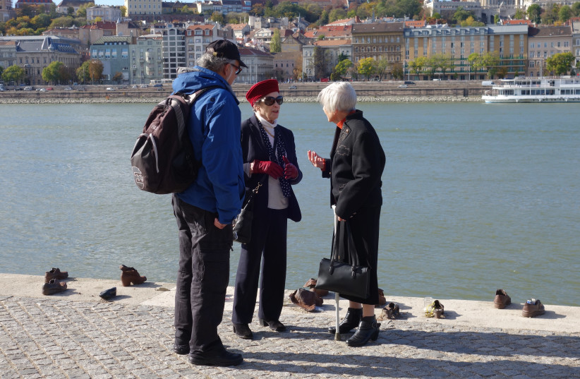 IDEON HARTMAN (left), Anki Tauber (center) and Vera Rudnai stand near the Holocaust memorial by the Danube River in Budapest, commemorating the murder of Hungarian Jews shot and thrown into the river by the Cross Arrow fascists. Tauber and Rudnai fled to Budapest from Amsterdam in 1943 (photo credit: WILLY LINDWER)