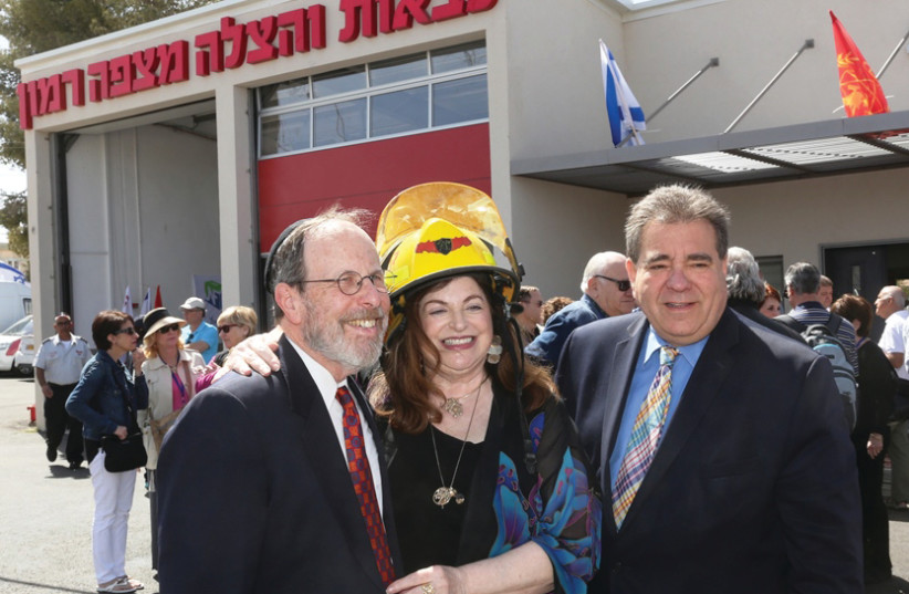 STEPHEN AND PENNY ROSEN with JNF-USA CEO Russell F. Robinson at Mitzpe Ramon's new fire station dedication in 2016 (photo credit: JNF)