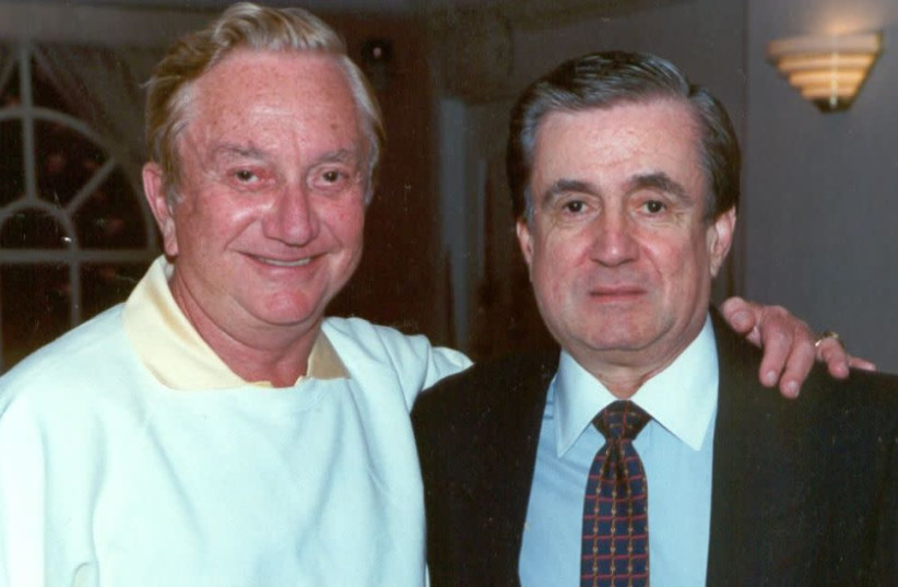 Corporate conglomerate billionaire & legendary financial tycoon, Meshulam Riklis (left) with dear friend & Riviera Vice-President, Sam Distefano (rt) celebrating Riklis' 65th birthday, Dec 2nd, 1988 at the Riviera Hotel and Casino, Las Vegas. (photo credit: WIKIPEDIA)