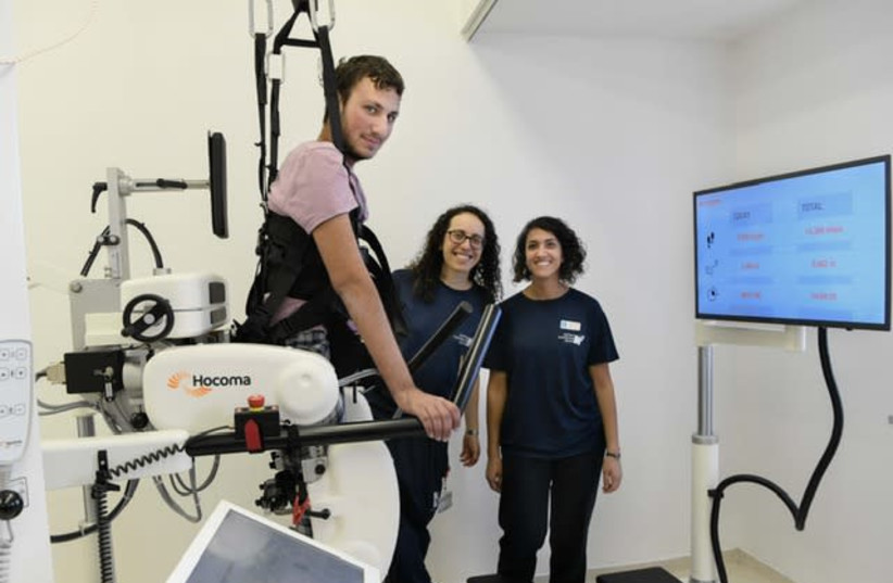 IDF combat soldier Dvir Teitelbaum uses Hadassah Hospital's new Lokomat robotic walking system (photo credit: AVI HAYUN)