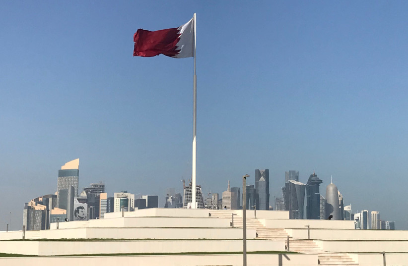 The Qatari flag is seen at a park near Doha Corniche, in Doha (photo credit: REUTERS/IBRAHEEM AL OMARI)