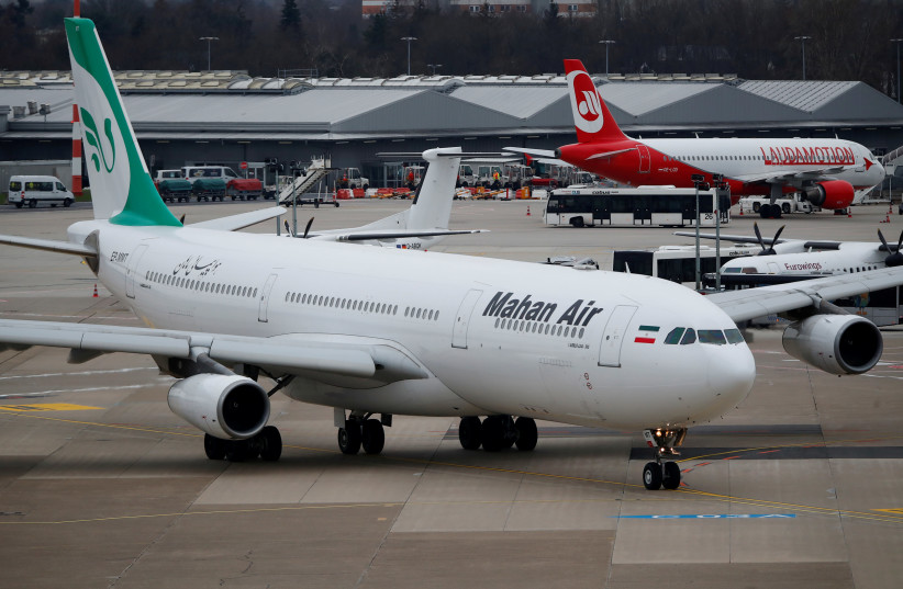FILE PHOTO: An Airbus A340-300 of Iranian airline Mahan Air taxis at Duesseldorf airport, Germany, January 16, 2019. (photo credit: WOLFGANG RATTAY / REUTERS)