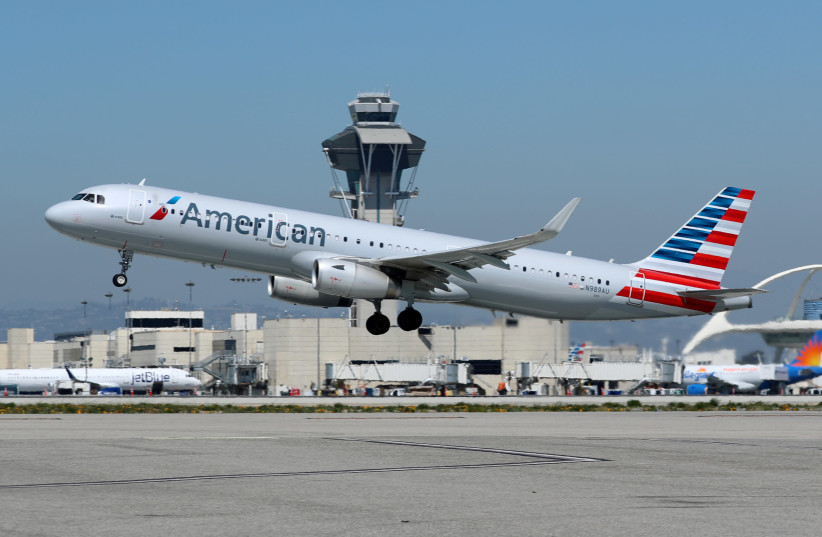 An American Airlines Airbus A321-200 plane takes off from Los Angeles International airport (LAX) in Los Angeles, California, U.S. March 28, 2018 (photo credit: REUTERS/MIKE BLAKE)