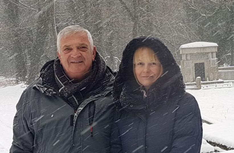 Alon Goldman and Aleksandra Janikowka Perczak in snow covered Jewish cemetery in Czestochowa (photo credit: Courtesy)