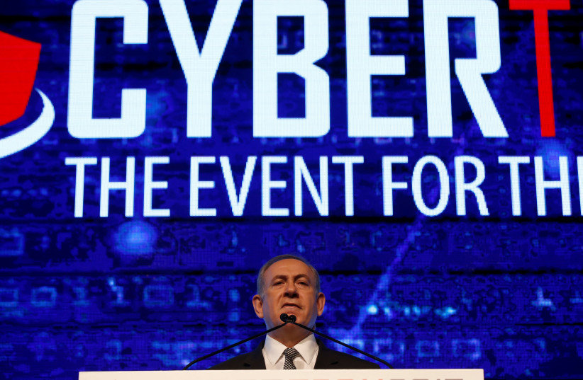Prime Minister Benjamin Netanyahu delivers a speech at a Cyber Security Conference in Tel Aviv, Israel January 31, 2017 (photo credit: BAZ RATNER/REUTERS)