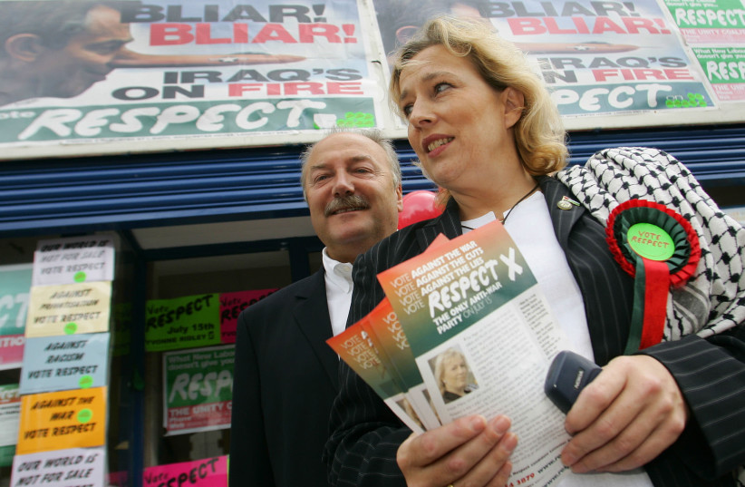 Leader of Britain's Respect party, George Galloway (L), and party candidate Yvonne Ridley (R) convas during a by-election in the Leicester South constituency in central England, July 15, 2004 (photo credit: DARREN STAPLES/REUTERS)