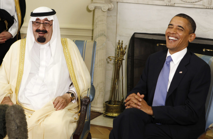 Barack Obama (R) laughs as he meets with King Abdullah of Saudi Arabia in the Oval Office of the White House in Washington June 29, 2010 (photo credit: LARRY DOWNING/REUTERS)
