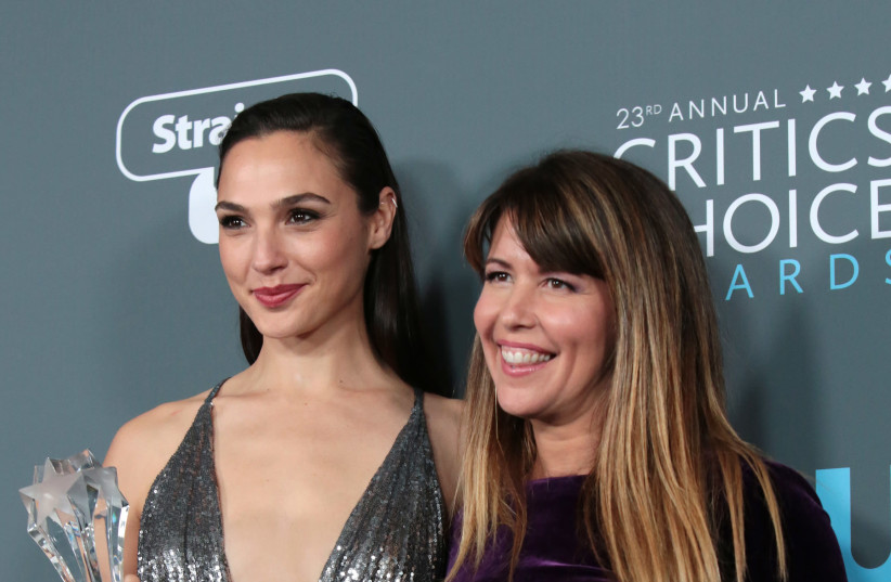 """23rd Critics' Choice Awards – Photo Room – Santa Monica, California, U.S., 11/01/2018 – Gal Gadot (L) and Patty Jenkins pose with their award for Best Action Movie for """"Wonder Woman"""" (photo credit: MONICA ALMEIDA/REUTERS)"""