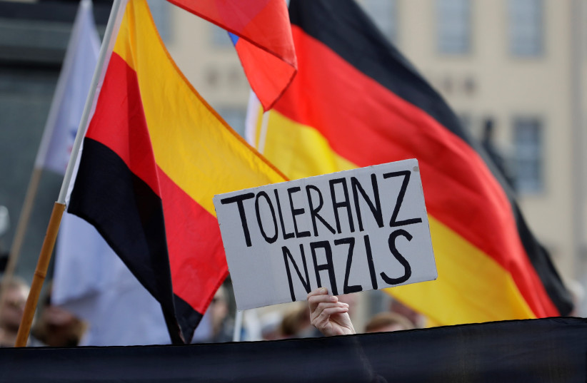 Supporters of the anti-Islam movement PEGIDA (Patriotic Europeans Against the Islamisation of the West) attend a demonstration in Dresden, Germany, October 21, 2018 (photo credit: DAVID W. CERNY / REUTERS)