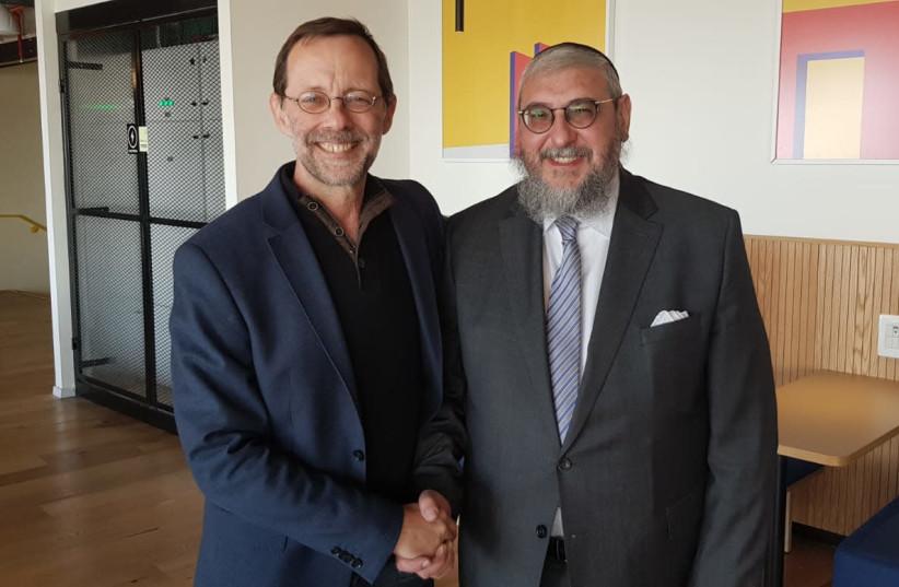 Moshe Feiglin [L] shakes hands with Rabbi Haim Amsalem [R].  (photo credit: Lahav Harkov)