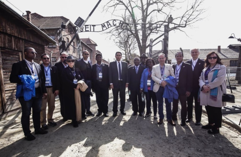 UN diplomats in the Auschwitz museum in Poland, at the center, Israeli ambassador to the UN Danny Danon 2018 (photo credit: Courtesy)