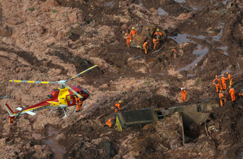 Rescue crew work in a dam that burst in Brazil (photo credit: Courtesy)