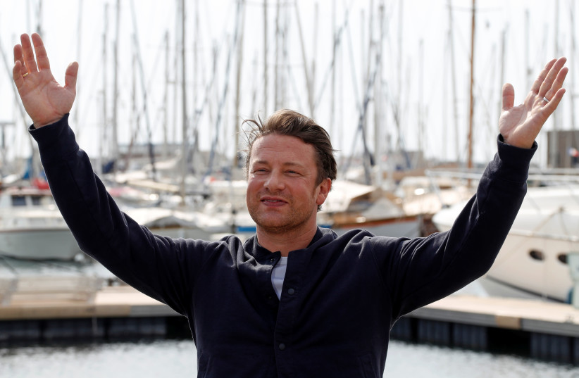 Chef Jamie Oliver poses during a photocall at the annual MIPCOM television program market in Cannes, France, October 15, 2018. (photo credit: ERIC GAILLARD/REUTERS)