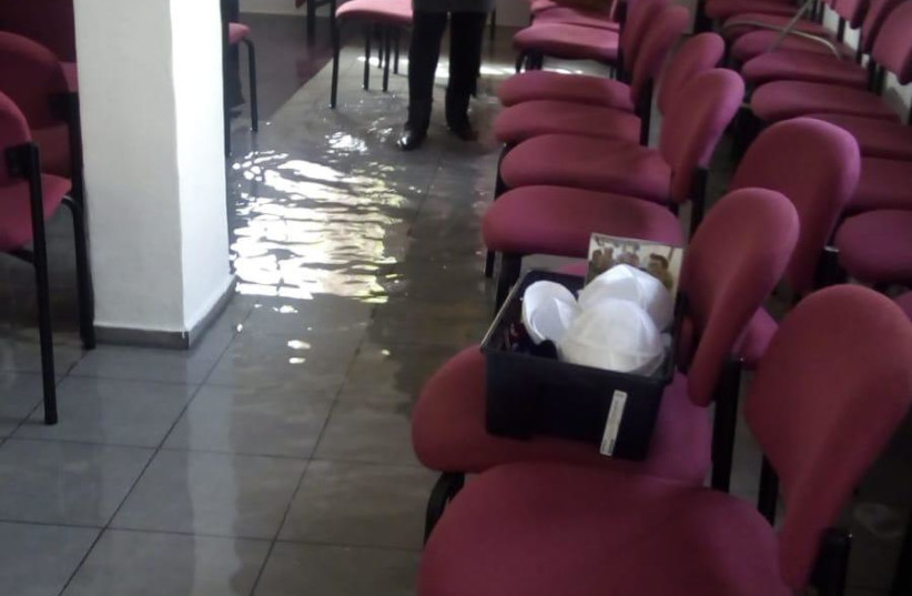 The flooded synagogue in Netanya after vandals inserted a hose through the window (photo credit: Courtesy)