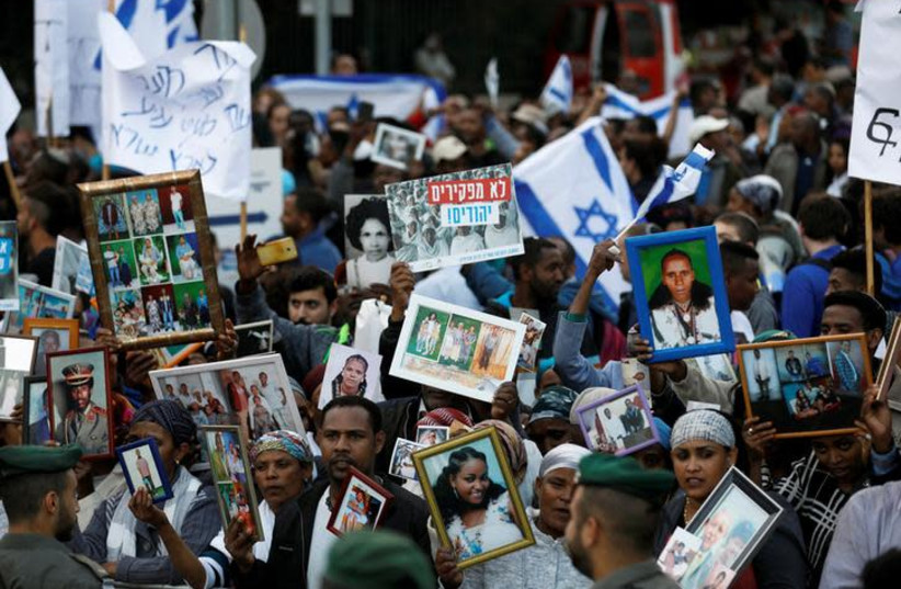 Israelis of Ethiopian descent take part in a protest (photo credit: REUTERS/Ronen Zvulun)